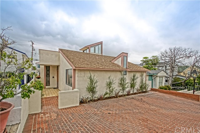 Located in the coveted Gaslamp District in the Manhattan Beach Sand Section, this 2,353 sq foot home sits on a OVERSIZED 40' X 106' street-to-alley lot. With its unique architecture and hip vibe, this home has tons of potential. The master suite opens to a massive roof deck with mountain and Downtown LA views. There are two living areas, dining room, and two large courtyards for entertaining. Oversized garage, with workshop area, separate laundry room and parking for 5+ cars at the beach! The location is right in the middle of the action, just steps to award winning Grandview elementary, Live Oak park, downtown Manhattan Beach, and of course the sand!