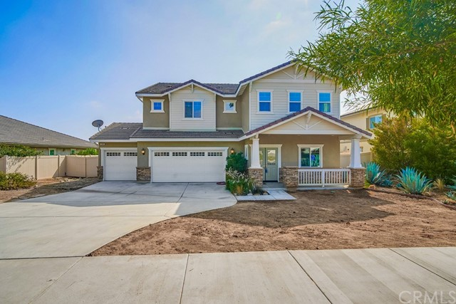 Stunning two level N Upland home, above the 210 fwy! This beautiful property is nearly 3,300 sq. ft. built in 2014, and sits on over 10,000 sq. ft. of land.  The elegant double entry glass doors lead to dark scraped wood laminate flooring, high ceilings, fresh neutral paint and new designer carpeting.  There is an oversized bedroom on the main level, and a nicely appointed full bath.  The open living and dining room are perfect for formal gatherings, and the gourmet kitchen with large prep island, walk in pantry, gleaming granite counters and stainless appliances opens to the informal dining and spacious family room, making entertaining both large and small groups a pleasure! The second level contains the grand master bedroom with valley and city light views, two large walk in closets, and a sumptuous en-suite with dual sink granite vanities, a large oval soaking tub, separate glass enclosed walk in shower and private water closet.  There are three additional bedrooms, a full jack and jill bath and sizeable laundry room with sink on this floor as well.  The back yard is an entertainers dream, with a lattice covered patio, terraced concrete and trex style decking, a marble topped bar/prep island with stainless steel b-b-q and mini fridge, and a sparkling resort style swimming pool and elevated spa.  Owned solar,  three car garage, potential RV parking, excellent N. Upland schools and close proximity to the Colonies shops and dining, make this a wonderful place to call home!