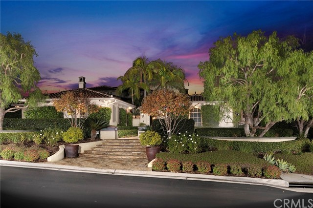 The crown jewel of Tustin Ranch Estates set atop an expansive 29,054 square foot corner lot, this slice of paradise exudes extravagance throughout! Rich in sophistication, this coastal contemporary sanctuary offers views of the spectacular backyard from every room. Chef-inspired kitchen & grand living space open to multiple entertaining areas, most notably an open-air lanai adorned w/Sapele wood ceilings & full custom bar offering unobstructed views through disappearing pocket glass doors that blend the home into its outdoor paradise of lush tropical gardens and cascading waterfalls. 4 bedrooms, including the master, are on the main level for a single-story feel, along w/ 4.5 baths, music room & office. 2nd-story great room offers panoramic views from adjacent viewing deck, plus 2 bedrooms and a full bath with a steam shower and dual towel warmers for the most discerning guests. Crafted as a seamless extension of the estate's natural surroundings, every inch of outdoor space is complemented by lavish amenities, including mature Canary Island palms, private grotto, thatched-roof palapa bar, outdoor kitchen & fireplace, cavernous waterfalls, salt water pool & spa, 20-ft slide, sunning deck & charming child's treehouse. This home's desirable corner location and masterful resort-style craftsmanship make this a rare opportunity to purchase your own piece of paradise in the highly sought after, guard-gated community of Tustin Ranch Estates.