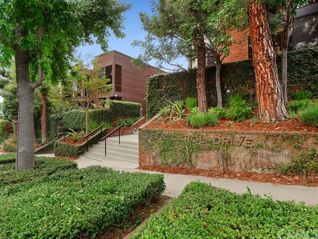 Beautifully renovated, two-story unit in the Carolwood in upper West Hollywood!  Architecturally significant and well positioned complex, adjacent to Beverly Hills! This corner unit has east, south and west exposure.  Over sized, updated kitchen with built in laundry next to the guest bathroom.  Formal dining room and step-down living room with a fireplace. The upper floor offers a master bedroom suite & second bedroom with a bathroom in the hallway. Completing the special residence is a large, private outdoor patio. The entire complex features outdoor courtyard and gorgeous resort-like pool and spa, and private saunas.  Two assigned parking spots side-by-side in the gated garage.  Don't miss this fantastic unit!