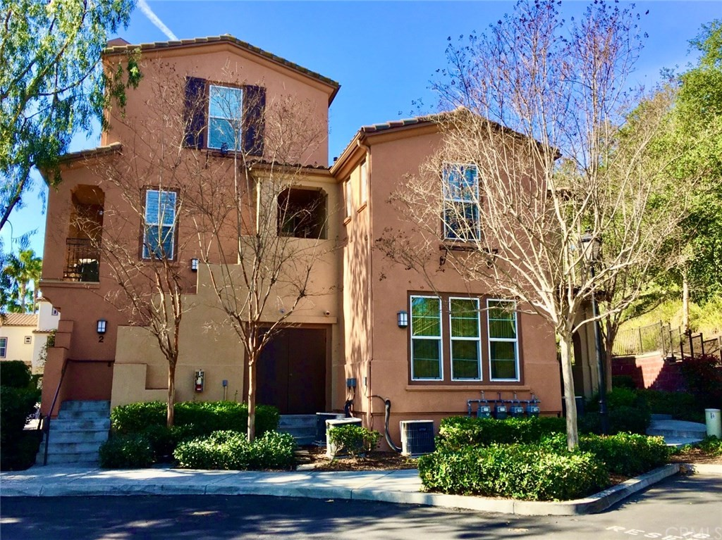 Style, charm & move-in ready. Absolutely spotless, upgraded upper-end unit has everything you need to live the good life in Ladera Ranch. The proof starts in the Tuscan inspired Sansovino community. This 1 bedroom PLUS LOFT  has been repiped w/PEX & is light and bright with lots of windows allowing for an abundance of natural sunlight. Discover features found only in homes double this size. You'll love the beautiful Eldon white porcelain tile flooring with custom baseboards adorned with crown molding & accented with shutters. The kitchen is upgraded kitchen with newer GE stainless-steel appliances, custom premium Kraftmaid cabinets, LED under counter lighting, handsome Silver Lennon granite countertops with brushed nickel hardware. More big house amenities include newer solid core doors with brushed nickel hardware, newer electrical outlets & switches, ceiling fans, premium carpet in the master bedroom and upgraded bathrooms with newer countertops and upgraded vanities. Cozy dining area & gas fireplace too! Attached garage (with one additional parking spot!) Upstairs is the spacious master bedroom with walk-in closet & a beautifully updated bath area. A convenient loft with built-ins makes for the perfect office space. Full size laundry closet with full size washer/dryer (included) is also located on the upper level. HOA amenities include high speed internet, award winning schools, pools, clubhouses, water parks, skate park, dog park, community events, biking & hiking trails.