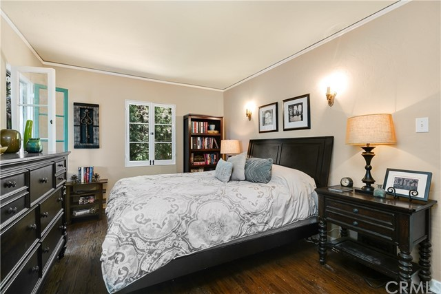 Master Bedroom with Hardwood Floors and Wall Sconces