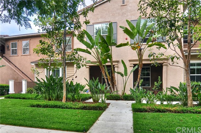 Highly upgraded townhome situated on a lovely canopy, tree-lined street in upscale Quail Hill Neighborhood. High ceilings, ceramic tile flooring downstairs, Plantation shutters, large and open downstairs living area. Full bedroom and bathroom downstairs. Beautiful kitchen with granite counter tops and stainless steel appliances with refrigerator. Spacious upstairs master bedroom including an extra large master bath, large walk-in closet with custom closet organizer. Upstairs laundry room with hook-up's for washer and dryer, sink and cabinet. Surround sound system and iPod docking stations on wall for music or for charging. Attached 2 car garage with direct access to home. Walking distance to Award-Winning Alderwood Elementary School, Quail Hill Shopping Center, and nature trails. Short driving distance to John Wayne Airport, Laguna Beach - with quick access to the 405, 5, and 133 Freeways. Perfect move-in condition!