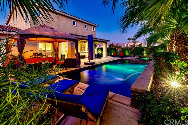 Welcome to the most stunning home at this price range anywhere in the valley! This corner lot home is located in the coveted community of Shadow Ranch! The home is being offered turn-key furnished with higher end furnishings inside and out! The first floor and staircase has beautiful bamboo flooring that is scratch resistant. The family room and kitchen have been nicely upgraded with stacked stone for a luxurious finish. The kitchen was remodeled with high end Quartz countertops, backsplash and warm tone paint colors. The home was also recently painted on the interior. Most windows have custom built wooden shutters and this open floor plan flows like no other! The laundry room is large with a built-in desk. The upstairs has an impressive master bedroom with a private balcony that overlooks the gorgeous mountains! The backyard is known as LUX GRAND and is a water lovers paradise. The sparkling saltwater pool with attached spa, 3 cascading waterfalls, gas fire bowl, waterfall pond and tanning ledge. This home is ideal for families looking for indoor and outdoor living at its best!! Potential seasonal 30 day minimum vacation rental home. Seller has rented this home out for $9,000 to $10,000 per month in the past.