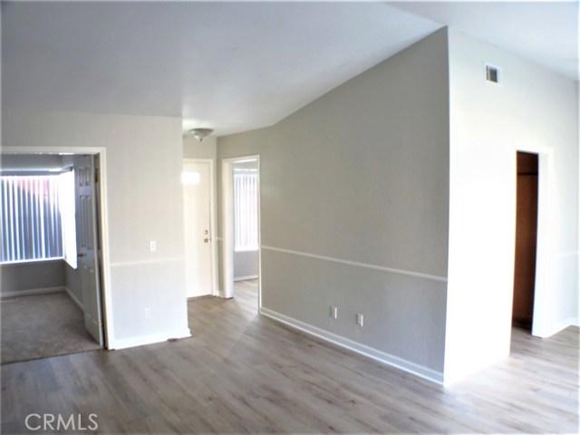 Left to right: Bedroom, front door, kitchen.