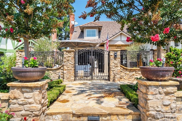 Gorgeous masonry accentuates the curb appeal, patio has a beautiful stone medallion. Private entry gate includes security cameras.