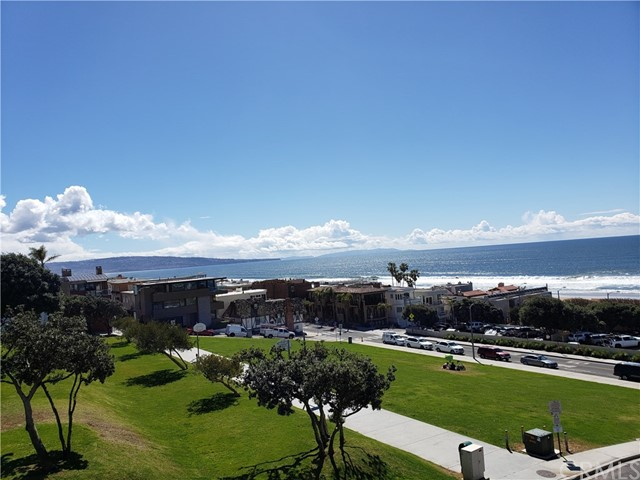 The ultimate Manhattan Beach ocean view experience is now available for buyers looking to create their dream home or remodel a classic beach property. Just a few steps from The Strand and the wide beaches of Manhattan Beach, 219 27th Street is situated on one of the most ideal view streets in all of the South Bay. This south facing home captures coastline views from the main bedroom, the living room and the upper roof/deck area. Unlike other view properties, these views capture Palos Verdes Peninsula, Catalina, the Manhattan Beach Pier, Hermosa Beach Pier and from the roof/deck area, you can see all the way to Malibu and Point Dume. Located just north of downtown Manhattan Beach, you can walk to the shops and restaurants near the Manhattan Beach Pier or North Manhattan. Award winning Grand View Elementary School is a short walk away for those looking to embrace the best in class Manhattan Beach schools. This duplex property consists of 219 and 221 27th Street, which includes the front three bedroom and two bathroom home and the rear two bedroom and two bathroom home with an ocean view and small yard. This property has many possibilities, ranging from remodeling the existing home to live in one unit and rent out the other, to maintaining a trophy rental property for long term upside, or to build your dream home.