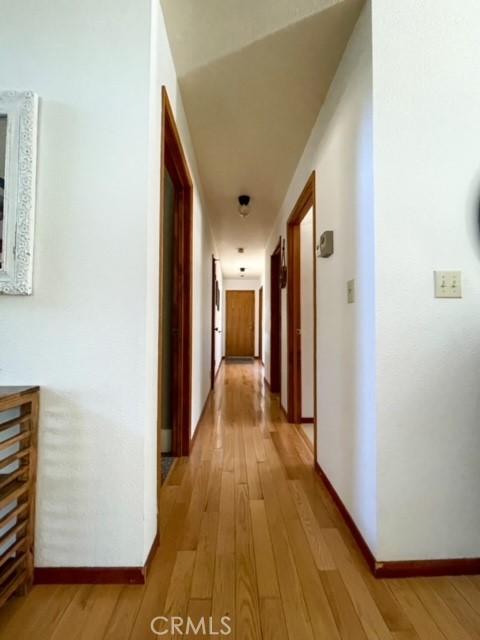 Hallway to master bedroom, bathroom, guest bedroom and bathroom plus laundry room.