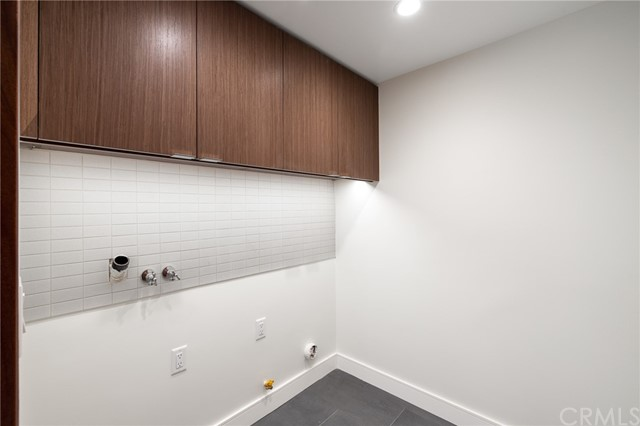 Separate laundry room with fine custom cabinetry