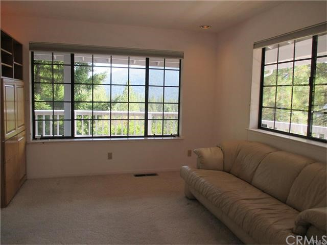 Family room is right off the dining/kitchen..   With panoramic views