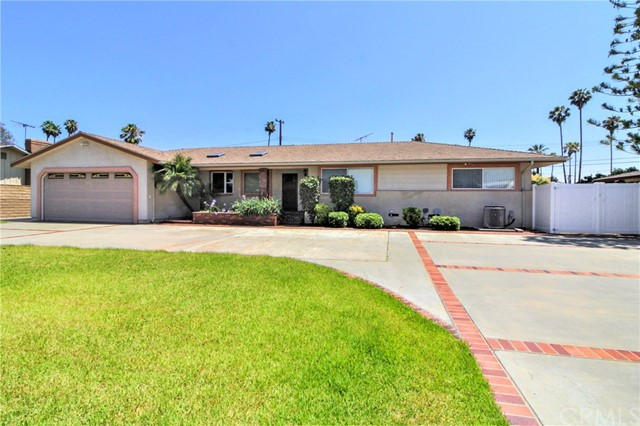 The entertainers dream home.  9562 Orangewood Ave, Garden Grove, CA 92841 is a 3 bedroom 2 ½ bath single story home.  Pool in backyard.  Approximately 1,973 sq ft of living space on a large 11,828 sq ft lot.  In ground pool in the backyard great equipment.  I love how the lot has segmented areas.  Security, Circular driveway with two gates.   Additional parking for possible RV on side of property behind additional gate.  Large expanded two car garage with plenty of extra room and attic storage.  Built-in cabinetry.  Must see kitchen.  The custom cabinetry sets off the kitchen and flow of the house.  Large living room with fireplace and dining room as you enter the property.  Family room is at the rear of the property offering a large common area with access to the different areas of the backyard.  A/C, water softer, and 3-storage sheds. We offer a virtual tour to be able to preview the property before seeing it.  A picture is worth 1000 words.