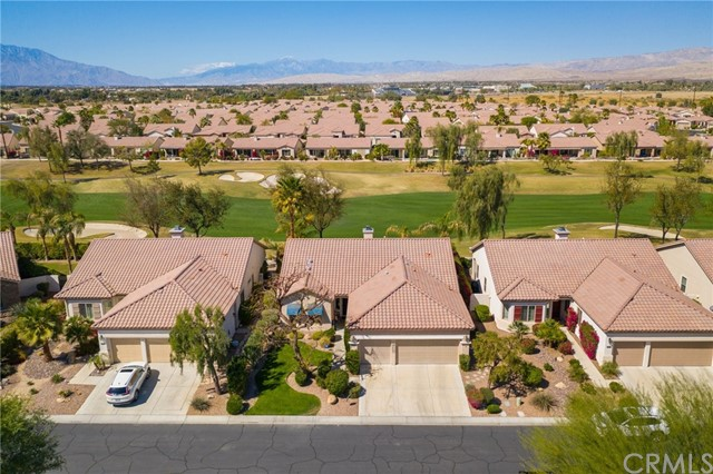 Beautiful ONE OF A KIND San Benito floor plan with Golf Course View & beyond of San Jacinto, San Gregorio & Shadow Mountains on a cul-de-sac. This is a MUST SEE... TOUR: https://www.aryeo.com/v2/80342-avenida-santa-alicia-indio-ca-92203-us-679021/unbranded..... Totally remodeled w/designer features & tranquil outdoor rock fountain-2 fire bowls & fire pit. Large main bedroom-golf course view, door to patio w/ Meshtec security screen, custom barn door opens to private remodeled oversized walk-in shower-custom tumbled travertine, new vanity-Cambria travertine, copper double sinks, medicine cabinets, make-up seating, travertine flooring & huge master closet + linen storage. Remodeled guest bath offers designer tile & built in niche. Crown moulding throughout, tile flooring except for 2 bedrooms, custom paint & window coverings/shutters. The kitchen is a chefs dream w/ space for everything! Re-glazed cabinetry in a rich tone, separate kitchen dining + counter bar. Adjacent is a formal dining space opened to a great room with windows across the back bringing in the picturesque surroundings. SAN BENITO FLOOR PLAN offers 2 bedrooms, oversized office + hobby room (currently used as a 3rd bedroom). Enjoy outside dining under the Alumawood patio cover while listening to the sounds of nature- Garage offers 2 car spaces + golf cart parking, evaporative cooler (installed 2017), epoxy flooring, tons of cabinetry, newer garage door motor. Energy efficient HVAC system upgraded in 2014.
