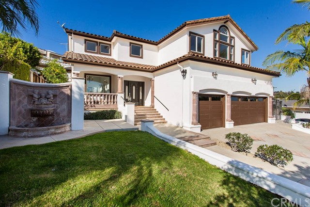 This palatial Mediterranean family home sits in Vista Del Oro's most secluded and desirable neighborhood. Built in 1999 and just masterfully updated, this opportunity is truly one of a kind! Your guests' jaws will drop as they walk into the grandest of entries, featuring 19ft high ceilings delightfully crowned with two extravagant chandeliers above the formal sitting and dining areas. Just past that you will find the massive kitchen complete with a wet center island that opens right up to a wonderfully bright and airy family room. The coolest of backyards peeks in through the windows, a truly complete and complimentary outdoor space guarantees no sunny San Pedro day is wasted- featuring a pool with waterfalls, fully loaded cabana area with built-in BBQ, sink, plenty of counter space, and a rustic Spanish half bathroom. Upstairs, your master suite is ready for relaxation, with a most decadent bathroom for two, sprawling views to the Vincent Tomas Bridge, harbor, and mountains.  There's room for everyone and all the toys here with 4 bedrooms plus an office/den, 4 total bathrooms, and a huge 3 car garage with enough height to build out whatever you may need.  A wonderfully designed house, perfectly located so close to the nicest shopping centers in the area, this one has it all!