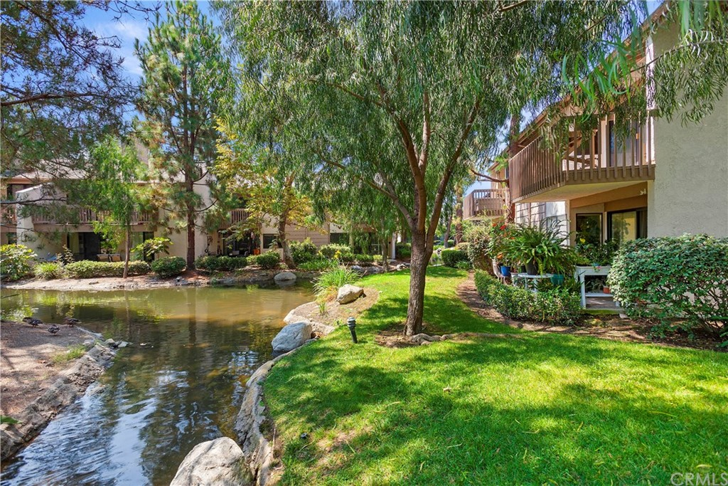 ONE OF THE BEST LOCATIONS IN QUAIL CREEK COMMUNITY. END UNIT WITH UNOBSTRUCTED VIEWS. The sounds  of running streams and soothing ponds encompass this very private upper end unit with cathedral ceiling.   Highly upgraded with extensive custom woodworking throughout. Upgrades include custom kitchen cabinets, stone counters,closet organizers, custom lighting, cathedral ceilings, skylight, and large deck off the living room.  Association two pool/spa's, sauna, two tennis courts.  Covered 160SF Carport, space #679.  Laundry closet for stack washer/dryer in master bedroom.