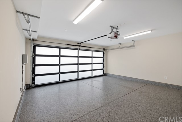 3-Car garage with epoxy floors and stacked laundry (2nd laundry area)