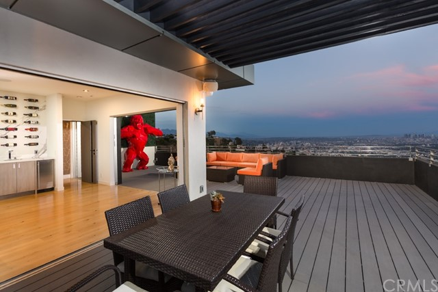 Perched atop Sunset Plaza, this meticulously crafted contemporary home offers breathtaking views of the Los Angeles skyline. The sprawling open concept floor plan creates the perfect space for hosting friends and family alike. This luxuriously finished home boasts gourmet eat-in kitchen with adjacent family, dining room, 5 bedrooms, and a beautifully appointed master bedroom with huge walk-in closets and bathroom. The expansive rooftop deck offers one of the finest views of Los Angeles only the Hollywood Hills can offer. Additional plans completed and ready to issue for a new pool and home theatre.  This home can be sold in conjunction with 1623 Viewmont Dr. (PW21030708) and 1680 Sunset Plaza Dr. (PW21030715). All three homes have historically been rental properties and have an exemplary rental history. Included in the sale is the option for the rental website domain and access to a 55-broker network.