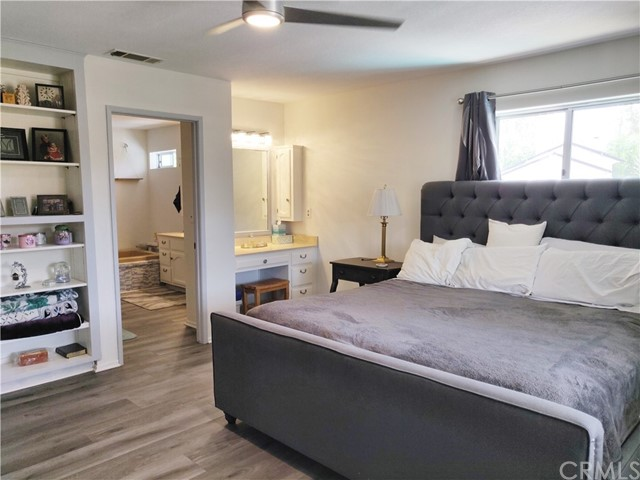 Main level master suite w/ walk-in closet & make-up vanity