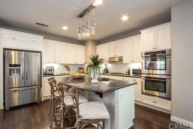 Spacious upgraded kitchen with center island & breakfast bar
