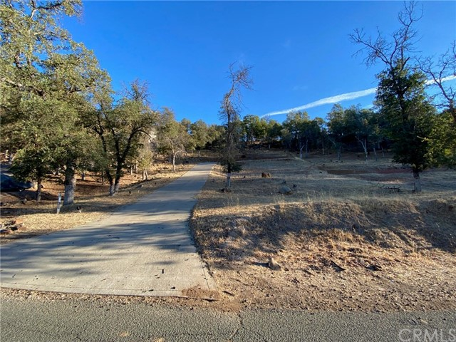 Ready to build on Moonridge Rd! Oversized .82 acre parcel in a desirable neighborhood with sweeping views and a tree covered setting. Water meter and sewer hook up fees have been paid, which is a $19k savings! Don't miss this opportunity to build your dream home at beautiful Hidden Valley Lake!