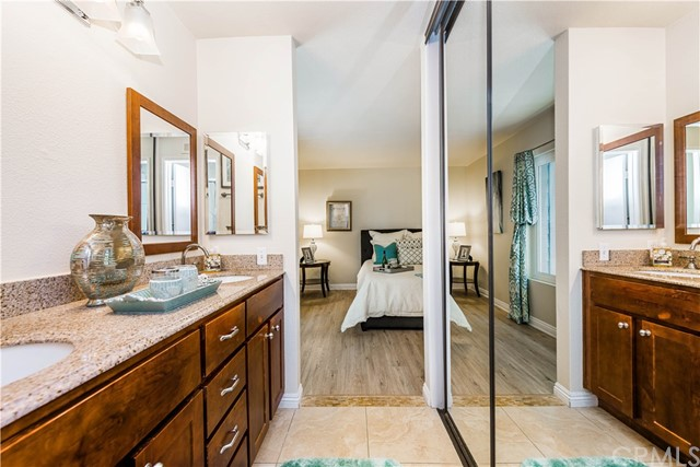 A view from the remodeled bath into the master bedroom. Note the mirrored wardrobes!
