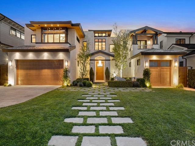 Complemented by its prime setting in Newport Beach's highly desirable Cliffhaven neighborhood at ocean-close Newport Heights, this award-winning architectural masterpiece offers the ideal blend of timeless modern design and clean aesthetics. Created by Brandon Architects and built by Pinnacle Custom Homes, the open-floorplan design is centered around an expansive two-story living, dining and kitchen space with a stacked-stone fireplace, exposed structural elements and clerestory windows. High-end appliances, an oversized island with bar seating for friends and guests, and a catering area enrich the kitchen, and 5 sets of sliding glass pocket doors that allow for perfect indoor/outdoor flow. Five ensuite bedrooms and 7 baths are revealed in nearly 6,800 square feet, and the subterranean level boasts a state-of-the-art home theater, gym, pub-style bar and a wine room-the ultimate spot for impressive entertaining. An elevator serves all 3 levels, as does a floating staircase that is accompanied by a 30' granite waterfall. Enjoy a luxurious escape in a primary suite that pampers with a steam shower, fireplace, and a spa-caliber bath. Intimate outdoor areas include a courtyard with fire pit, a loggia with fireplace, a generous glass-tiled spa and a built-in BBQ. Limestone flooring on the first level, a Vantage lighting system, and a leading-edge Control 4 smart-home system are featured. Cliffhaven places residents just minutes from beaches, Newport Harbor, Fashion Island and more.