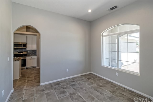 WOW! GORGEOUS New Construction situated on a huge, just under 2 acre  lot with great views of the desert !!! Four Bedrooms & 2.5 Baths. Master with Large Closets & Separate Tub & Shower. Separate Family Room w/ F.P & tile flooring. Large Kitchen with with solid surface counter tops, tile flooring, lots of cabinets & large pantry.. Formal Dining, Breakfast Nook, Indoor Laundry & 3 car garage. Lot size is approximate.