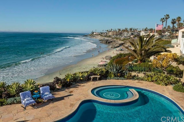 Location, location, location, Ocean Front, large mosaic pool, private beach access to be sold as-is, great opportunity add on, redo, or build your dream home. Rare and exquisite location for this OCEANFRONT one of a kind on WindanSea Beach in La Jolla, California. A Surfers paradise, big rock the shack, sandy beach endless sunsets.             It is one of few homes with private, w/ a private mosaic pool, expansive views, direct gated access to a sandy beach, and endless sunsets. From the moment you enter the gated private entry and step into the private tropical courtyard with its fountain and tropical plants with views directly out to the magnificent Pacific Ocean.           Numerous sliding doors from most rooms open onto the veranda and downstairs provide breathtaking views as you hear the sound of waves crashing on the shore. This private two-story enclave consists of 7 Bedrooms and 5 Bathrooms plus a kitchen/family room, living and dining to seat 12-14, a downstairs family/pool table room, two romantic master suites two walk-in cedar closets, dressing rooms, and direct access to the beautiful mosaic pool, patio area on the ocean side of the property. In addition to 2 more bedrooms overlooking and lounge around the mosaic-tiled pool and take in the magnificent pacific ocean breeze. A dream come true.