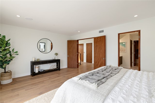 Grand double doors open to the Master suite with private bath (shown here using reverse of 961 Unit A staging)