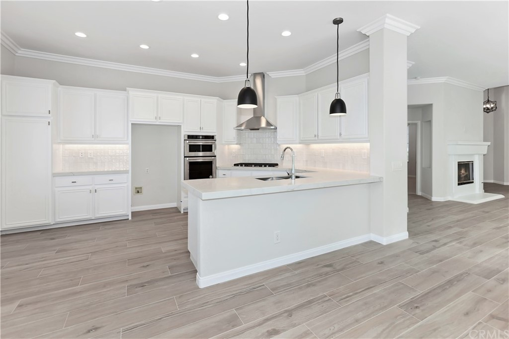 Remodeled single story home with GOLF & SUNSET VIEWS!  Located on a single loaded cul de sac lot located on the Tee Box at Hole 6!!  This 2 bedroom PLUS OFFICE/DEN  & 2 bath home has been upgraded with all NEW ITALIAN  LIGHT WOOD LOOK TILE THROUGHOUT, with exception to NEW HIGH QUALITY PLUSH CARPETS in bedrooms! ALL NEW DESIGNER PAINT, INDIRECT LED LIGHTING, KITCHEN & BATH DESIGNER FIXTURES THROUGHOUT, NEW KITCHENAID STAINLESS APPLIANCES, NEW GAS COOK TOP & HOOD, QUARTZ COUNTERTOPS, NEW DESIGNER TILE BACKSPLASH, NEW SINKS & TOILETS, WATER HEATER NEW 2019, NEW DESIGNER MIRRORS, PLUS BUILT-IN TV CENTER IN FAMILY ROOM.  Light, bright open floorplan that opens up to the views in back,  private location, gated courtyard entrance, wrap around walk way from the backyard to the garage AND TONS OF BUILT-IN STORAGE CABINETS IN GARAGE.  Washer & dryer are included.  This property is for a discerning tenant who wants luxury!