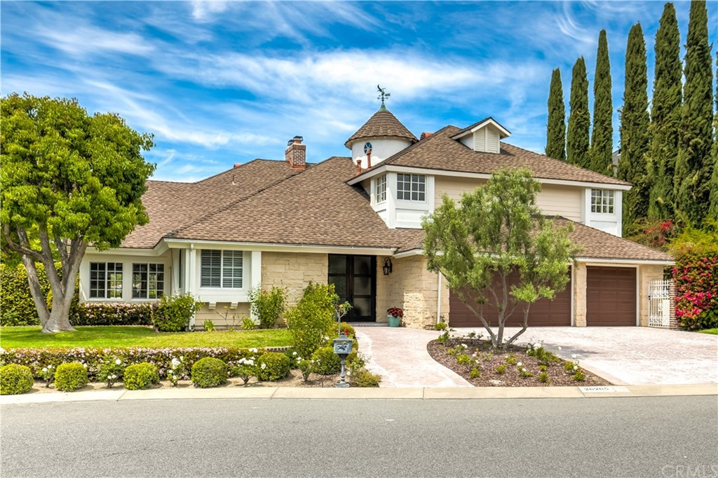 This stunning 5 Bedroom, 4-1/2 Bath Custom Home has a Prime Location in the Cul-de-sac of one of the most coveted estate-lined streets in Nellie Gail Ranch!  Serene and Private with Views of the hills, trees, and homes in the distance.  Understated elegance is highlighted by warm wood flooring and stone-accented walls that immediately draw you into the home.  A sunny Office/Study is adjacent to the two-story Foyer.  The living room is equally bright with high beamed ceilings and a handsome fireplace.  French Doors at the formal dining room add to the ambiance of this beautiful home.  The Island Kitchen features a Walk-in Pantry, built-in Samsung Fridge, granite countertops, stainless steel appliances and a great view from the kitchen sink!  The breakfast nook is delightful!  Lined with windows and highlighted by the stacked stone corner fireplace that faces the family room.  A huge media center lines an entire wall of the family room!  There are over a dozen built-in speakers throughout the home!  A wall of glass with huge sliding doors opens to the backyard and the view.  There is a bedroom down with its own bath as well as a Powder Room and separate Laundry room with a sink.  The staircase curves up to a generous landing under the soaring rotunda.  The Master Suite and Retreat are gorgeous with French Doors to a large view deck...a perfect place to unwind!  Or you can relax in the master spa tub. You'll find 3 more spacious bedrooms and 2 more baths upstairs.  Welcome Home!