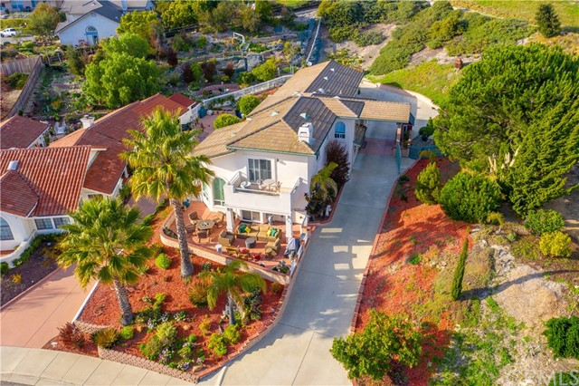 Ocean views are calling you! This luxurious home sits high on a cul-de-sac street on over a half acre lot. The inviting foyer entry has 2 story beamed ceilings and welcomes you to the heart of the home. The lower level has 3 bedrooms, one currently used as an office, however has a closet and bonus space to create your own walk-in. Enjoy the holidays and family gatherings feasting in the formal dining room, easy to share food fresh from the kitchen via the pass-through window. Or eat casually in the kitchen at the breakfast counter and prepare your libations at the adjacent dry bar. This kitchen is a cook's delight, equipped with a double oven, granite slab island for food prepping and a walk-in pantry. One of the best features of this home is the Living Room. The beautiful slate tile hearth fireplace adds character and a place to warm up by on cooler nights. The Living Room has large Palladian windows which gaze out to the Pacific. Access the incredible front patio from the Living Room where you can gather around the fire pit, BBQ, relax or entertain while taking in the stunning ocean views over Pismo Beach. Enjoy the same breathtaking views from the upstairs Master Suite private patio as well. The Master Suite occupies the entire second level, has a gas burning fireplace, includes a walk-in closet plus 5 piece ensemble Master Bathroom with step in jetted tub.
