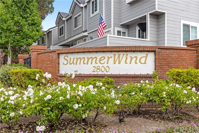 Upgraded Cape Cod style townhome in SummerWind, a gated, resort-like community coveted for its beautifully landscaped grounds and meticulously maintained amenities which include 3 pools, spas, a clubhouse, playground and safe streets for people of all ages and pets.  Features include a freshly painted interior, updated kitchen with granite counters and white cabinetry, hardwood floors and A/C.  The thoughtfully designed floor plan has living spaces that flow to a relaxing patio on the main floor, two spacious primary bedrooms with vaulted ceilings, generous closets and ensuite baths upstairs, and a lower-level laundry room, storage room, and 2-car direct-access garage.  The residents of SummerWind are friendly and enjoy concierge level service from an onsite manager, full time maintenance staff and a professionally run, solid HOA.  The surrounding neighborhood is pretty, open and full of greenery -  pass by the Madrona Nature Preserve and arrive along a tree-lined parkway street.  The area is peaceful and secluded-feeling, yet the beach is just 3 miles away, and you're minutes from popular Del Amo Mall, restaurants, a twice weekly Farmer's Market, great schools, hospitals and dynamic Wilson Park that's loaded with sports facilities.  It's hard to find this mix of affordable luxury, amenities and lifestyle.  Carpe Diem!