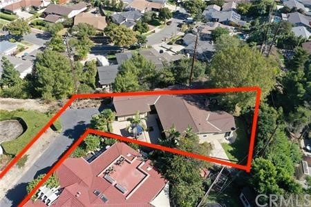 Red boundary lines in drone photos shown are an approximation of flat, useable lot, though the actual property boundaries extend beyond. Buyer to verify.