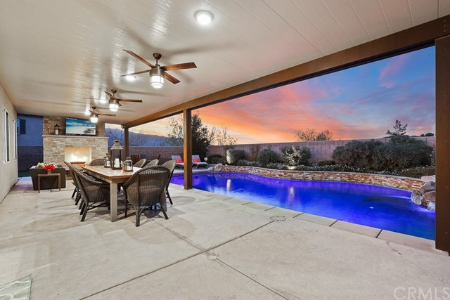 Insulated patio cover with recessed lighting and ceiling fans