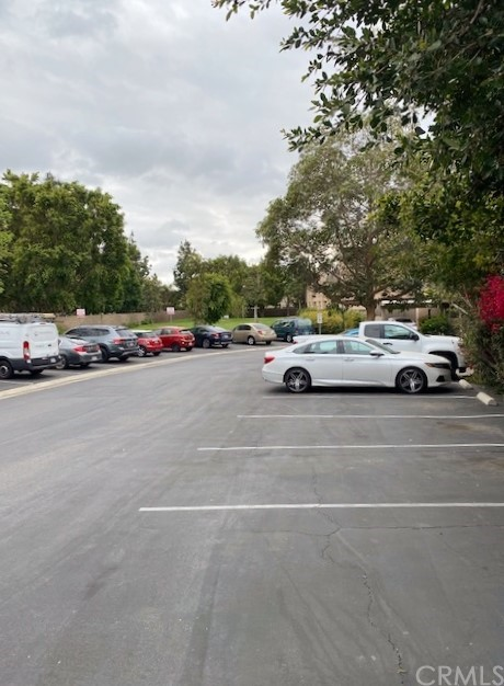 Entry to Tamerin Orange and guest parking and beautiful greeenbelt area.