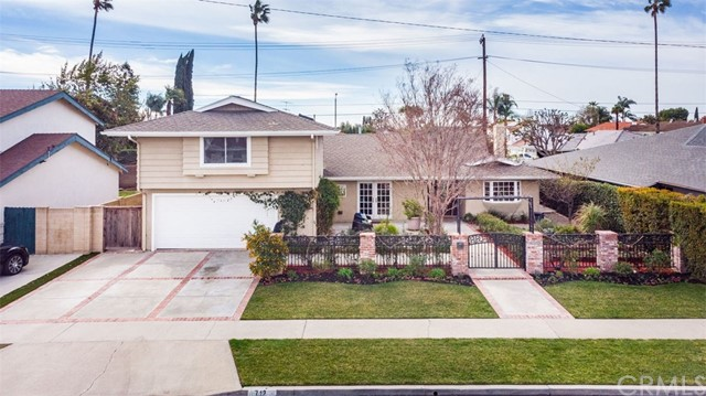 Stunning four bedroom, three bath home in the heart of Placentia. Amazing curb appeal with front wrought iron and brick gated entry leads to a flourishing garden and front entertainment patio with speakers. Gourmet kitchen features stainless steel appliances, smooth top precision electric induction cooktop, granite counters, rich wood cabinets with glass displays and soft closing drawers, and peninsula bar with seating.