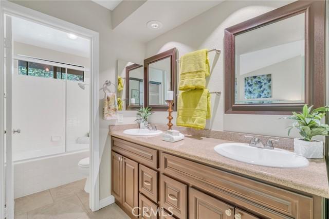 Master bathroom with a tub