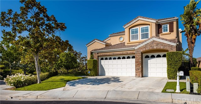 Located in the exclusive gated community of  ' The Gallery Collection ', this immaculate JM Peters view home w/ pool and spa, boasts luxurious living at its finest. As you enter into the gracious entry foyer it leads to a bright & open floor plan w/ a sweeping staircase, soaring high ceilings and a large living room that is flooded with an abundance of light. The spacious formal dining area features large French Doors w/side panels that open to the backyard. The beautifully landscaped yard is perfect for outdoor entertaining with a spa that waterfalls into the pool and a private gas fire pit. The Gourmet Kitchen is showcased with upgraded granite countertops & breakfast bar. Kitchen has built-in appliances including dual ovens, microwave and gas cooktop as well as spacious kitchen nook overlooking the gorgeous backyard. The cozy family room w/ a gas fireplace that opens up to the kitchen w/direct access to the backyard. This home also has highly sought after downstairs bedroom and bath. Walk up the stairs to find a spacious master suite that leads out to an oversized balcony to enjoy the amazing mountain and city light views. The beautifully remodeled master bathroom includes dual sinks, separate shower, stand alone soaking tub as well as a walk-in closet. Spacious secondary bedrooms with Jack & Jill bath. All bathrooms tastefully remodeled less than a year ago. Some of the many other upgrades include new plumbing, newer windows, wood floors through much of the home, Solar Panels, (which are paid for) among many other upgrades.  The community features 2 parks, one with a gazebo & fountain that only enhance the desirability of this community.