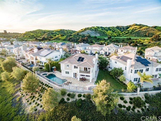 Endless PANORAMIC VIEWS stretching from East to West, enjoy views of OC and beyond and you can see Catalina Island on a clear day! Prime lot in a cul-de-sac, private and quiet location in The Masters/luxury homes community by Toll Brothers. This highly upgraded home  is equipped with smart home system that can be expanded to fit individualized needs: there is no detail missed to make this home a comfortable and enjoyable one. From the moment you walk through the front gate you will find yourself surrounded by stylish beauty of this absolutely gorgeous view home with 4 bedrooms, an office, a loft, spacious living, family and dining rooms, kitchen with walk-in pantry and a view, 4.5 baths and a three-car garage. Downstairs in-laws suite/guest bedroom will compliment everything else this beautiful home has to offer. From custom flooring to beautiful custom built-ins, each room with individual character yet consistent throughout - this home is a rare find. Built in 2009, it is a very bright home with great air flow. Open floor plan with views from family room and kitchen which has direct access to the dining room. All bedrooms each with their own walk-in closet and bathroom. Generous lot featuring a pool, spa, free standing sauna, BBQ island, lawn, flowers and trees including fruit bearing citrus tree and a side yard. Numerous upgrades throughout, including custom flooring with natural stone, decorative mosaics, wood, patterned carpet, custom made built-in office furniture, custom made entertainment center in family room, surround sound throughout, model match master bathroom with custom marble countertops and unique decorative tile bands, custom made built-in walk-in closet organization in master suite, view balconies off the master suite and one of the secondary bedrooms, separate laundry room with sink and included washer and dryer on the second floor, view from every window on the second floor, including laundry room, solar heated pool and spa, 2 floor ceilings in l