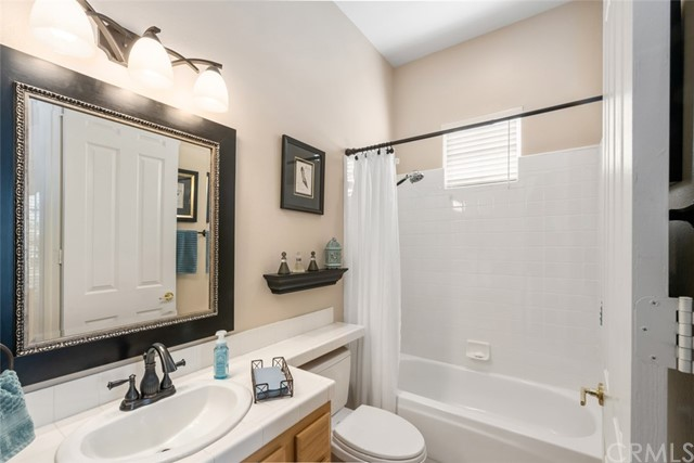 Secondary bathrooms with upgraded fixtures, and upgraded lighting