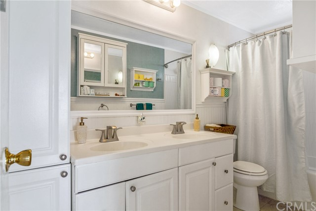 updated second bath features Double Sinks, Large Tiled Soak Tub, Updated Cabinets with tons of storage