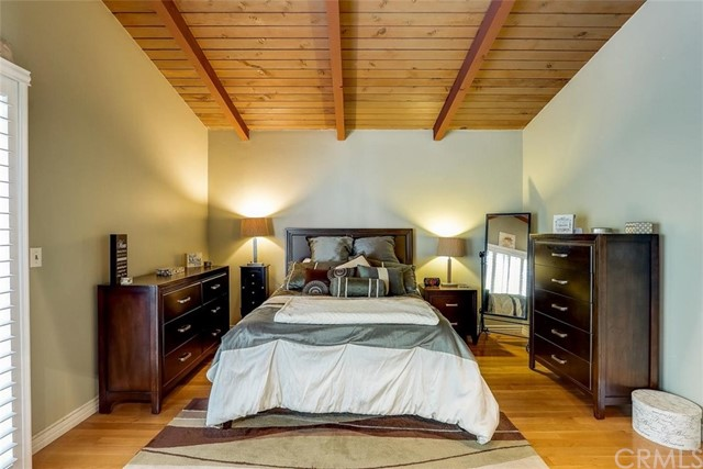 Primary Suite bedroom with private access to your back balcony overlooking your serene back yard.