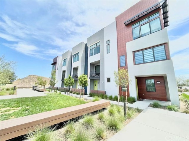 Coming soon to the market.  This gorgeous townhouse is situated in the brand new community of the Levity at Tustin Legacy.  It is a three-story end unit townhouse that features 3 bedrooms, 3.5 bathrooms & a bonus room downstair (easy conversion into a bedroom), with two car garage.  It is fully upgraded thru-out with Aamra Quartz Countertop, solid panel cabinet, wood flooring thru out the house, Hunter Douglas Blinds, etc.  The list is too long to put up, definitely a modern and smart home that's ready for its next home owner.  The residents in the community will also be able to enjoy access to The Connection, a 0.6 acre community recreation facility featuring a swimming pool, spa, barbecues.  Do not miss the chance to live a modern lifestyle in one of the best location in Orange County.