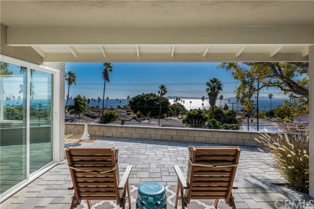 ***AMAZING FULL OCEAN AND VIEW OF CATALINA ISLAND!!!*** In this beautifully remodeled South Shores home you have panoramic views of the Pacific Ocean and Catalina Island from nearly every room! As you walk through the home, you will notice high-end light fixtures, large baseboards and crown molding throughout. Enjoy your morning coffee in the breakfast nook next to the kitchen while gazing out at the sea. Cook an amazing meal while watching the sunset in the kitchen with white shaker cabinets, grey Brazilian stone countertops, stainless steel appliances and built-in wine rack. The master bedroom has a large window where you can wake up every morning to an ocean view. The master bathroom features a cast iron claw foot tub and Carrara marble throughout. The laundry room boasts plenty of counter space for folding and organizing clothes. The backyard faces the ocean breeze and includes 2 raised planter beds ready for you to grow your own vegetables. Finally, take a deep breath and relax to the sound of the water fountain and Costa Rican butterfly vines growing in the Zen like garden on the west side of the property.