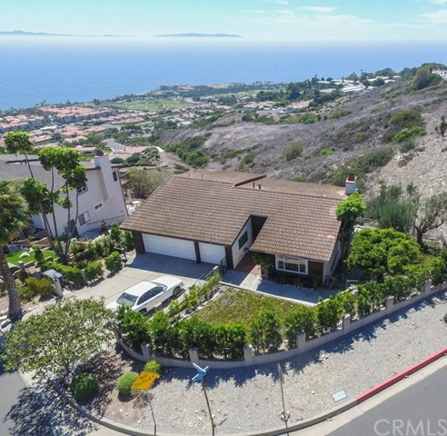 Panoramic views await you from this home in a premium Rancho Palos Verdes neighborhood!