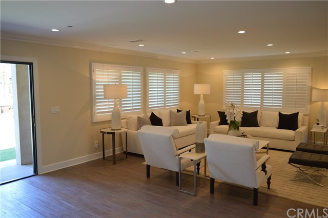 Plantation shutters in the living room and kitchen area for added privacy.