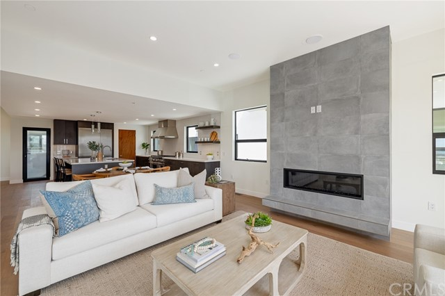 Statement floor to ceiling fireplace anchors the spacious living area (shown here using reverse of 961 Unit A staging)