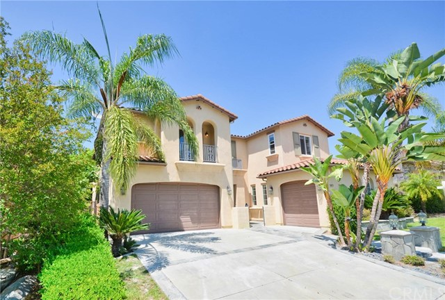 The Gorgeous Estate Home in the highly desirable gated Presidential Collection community. Located on a Cul-a-Sac over 11,000 sq. ft. Flat Lot. The total of 4,300 sq. ft. of living space with 5 Bedroom + Office, 4.5 Baths. Whole house is lavishly upgraded. Kitchen boasts High End Solid Wood Cabinets with Island, High quality quartz Counter Top, Mable and Glass Hexagon Rhombus Back-splash, Travertine floors, built in desk space, walk in pantry, and kitchen dining area which opens to family room with brick fireplace. New Republic SPC floor just installed on first floor. Sweeping staircase leads to second floor with custom hickory hardwood flooring throughout upstairs. Master bedroom/bathroom suite offers Double-Sided fireplace, marble floors, Azul Bahia granite, Jacuzzi Tub, Mirror TV, Towel warming drawer, Bedroom-Sized Walk-In closet, custom maple Built-in cabinetry. Three upstairs bedrooms / baths offer custom built-ins and Travertine / Granite upgrades. Great backyard entertainment paradise with Saltwater, Pebble-tech Pool, Spa, Rock Slide, Grotto with Waterfall, Fire-pit, fruit trees, Pool Safety Fence, and Gated Dog Run. MINUTES away from the Brea Mall, Coyote Hills Golf Course, Downtown Fullerton and Brea, Freeway Access, World Class Shopping & Dining.