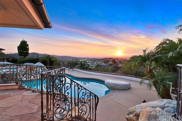 Mesmerizing Panoramic view.....Located on large private lot at the end of a cul-de-sac overlooking the most magnificent views of golf Course and a short walk from the Walnut Canyon Reservoir, this Luxury 3,383 sqft, 5 bedroom (1 Main floor with en-suite bath), 4bath home stuns in every way! You'll marvel at the views from the downtown Los Angeles skyline to the snow-capped mountains while you swim in the glistening smart pool and spa, lounge at the entertainer's patio, or host at the built-in BBQ with bar. Continue enjoying the view from the expansive Chef's kitchen with dedicated prep area, exquisite granite island and counter tops, bar, and abundant counter space and storage. The modern family room features a gas fireplace and built-in surround sound that extends to the patio. Host friends and family in the guest suite with outside access through the recently renovated bathroom. The first floor also features a bright dining room with views, an updated hallway bathroom, laundry, and a huge living room with gas fireplace and soaring ceilings, all adorned in natural stone and wood finishes.The second floor features three generously sized bedrooms, a full bathroom with two vanities, and a luxurious master suite. Enjoy more views from the sitting area in the master suite or the attached balcony with first floor access via the spiral staircase. The spacious master bath includes a walk-in closet, separate toilet with European-style bidet, two-person jetted-tub and steam shower with multiple shower heads. A three car garage offers room for three vehicles, a workbench, and loads of additional storage. Upgrades including high-end appliances, home network, LED lighting, custom window treatments and more!