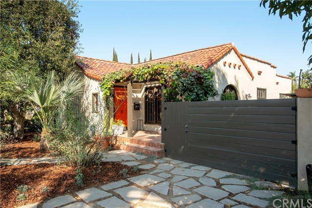 "Charming classic Spanish home,combining style,quality and comfort, creating your own special villa.Located in a great section of Belmont Heights,this special home's main house(approx.1534 sq ft)is adorned with vintage sconces and features coved ceilings,gleaming hardwood floors,and arched windows and doorways. A large formal dining room is central to the living space,adjoining the kitchen, living room and side yard patio. Honed granite counters,farmhouse sink,near new Fisher Paykel refrigerator and classic Jade Dynasty stove make this kitchen a cooking sanctuary.The coved ceiling living room w/arched window is warm and inviting. Privacy and serenity describes the gated patio.The master bedroom boasts a spa-like bath with double shower, whirlpool bath and wall hung,dual sink sandstone vanity. A Cal Closet organizer perfectly arranges the spacious walk-in closet.A multi-functional living space exists in the separate sound proof and insulated, 300 sq ft professional studio, which can be used as a media room, featuring a 72""screen and surround sound. It includes a ½ bath with premium quality fixtures perfect for a potential ADU.Additionally, the garage is separated into 2 one car garages and ideal as a bonus room/playroom/man cave. Drought tolerant front yard with native foliage and a fruit laden and herbal garden backyard,creates a model landscape. Solar panels, electric car charger, 2 tankless water heaters, central A/C,and custom window treatments complete this exquisite home."